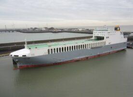Large cargo ship passing through Tower Bridge on Friday morning