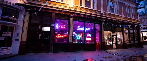 Neon lights filling Leadenhall Market